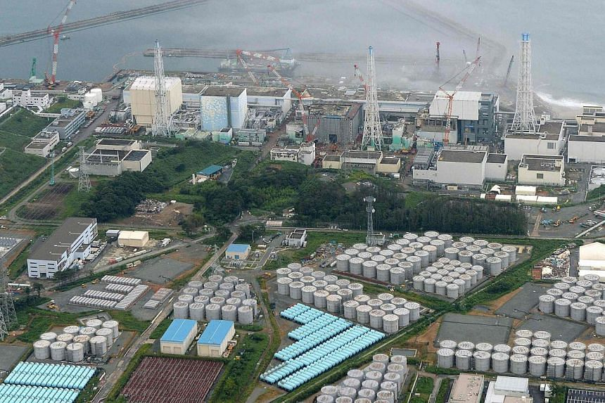 An aerial view taken by Kyodoshows Tokyo Electric Power Co (Tepco)'s tsunami-crippled Fukushima Daiichi nuclear power plant and its contaminated water storage tanks (bottom) in Fukushima on Aug 20, 2013.A system to decontaminate radioacti