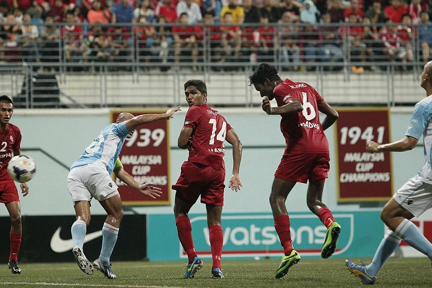 LionsXII's Madhu Mohana (No. 6) heads in the first and only goal of the Malaysia Cup quarter-final match against Malaysian club ATM at the Jalan Besar Stadium on Saturday, Sept 28, 2013. -- ST PHOTO: MARK CHEONG