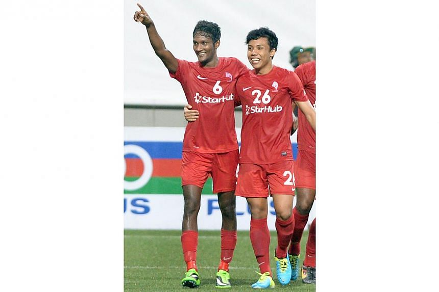 LionsXII's Madhu Mohana (left) celebrates his goal with teammate Shahfiq Ghani during their Malaysia Cup match against Malaysian club ATM at the Jalan Besar Stadium on Saturday, Sept 28, 2013. -- ST PHOTO: LIM SIN THAI