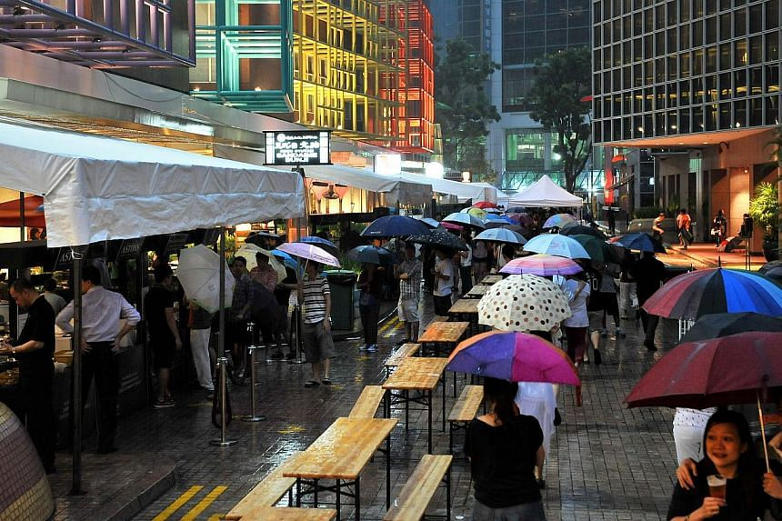 Heavy rain at the Ultimate Hawker Fest 2012 at Millenia Walk on Oct 20, 2012. Singapore should brace itself for warmer and wetter days in the next century. -- ST FILE PHOTO: KUA CHEE SIONG