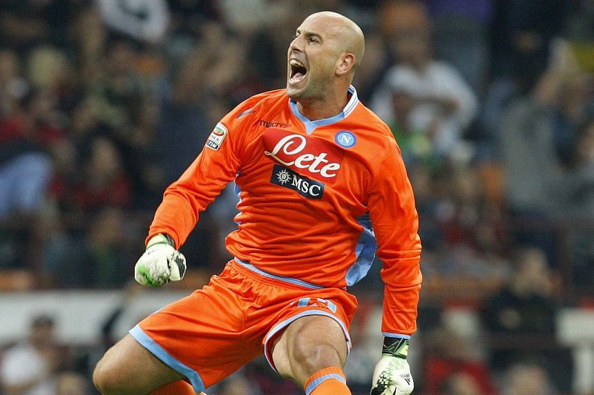 Napoli goalkeeper Pepe Reina celebrates after his team scores against AC Milan during their Italian Serie A football match at the San Siro stadium on Sept 22, 2013. Reina has admitted that he finds it hard to envisage returning to parent club Li