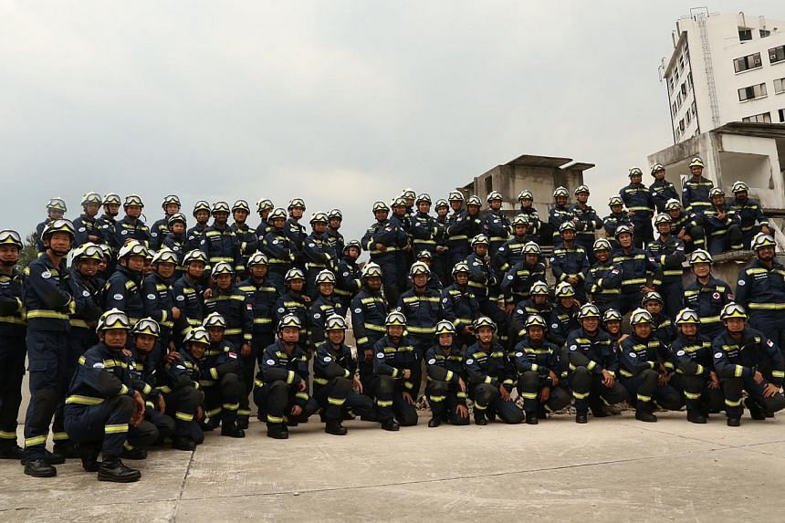 Members of theSingapore Civil Defence Force's overseas rescue unit, code-named Operation Lionheart. -- PHOTO: SCDF