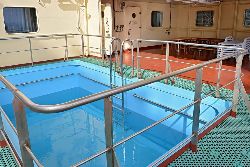 A swimming pool onboard the ship. The container ship was custom-fitted with various features that make it more energy efficient. -- ST PHOTOS: NURIA LING