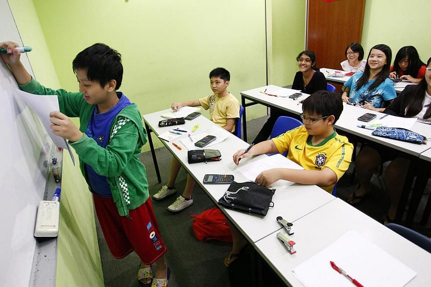 NIE's three studies on tuition are expected to be completed by the end of next year. One of the questions to be examined is whether tutors help students understand content or if they merely drill them to be exam-smart. -- ST PHOTO: DESMOND LUI