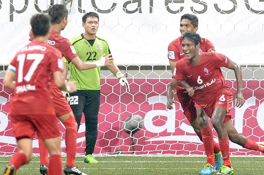 LionsXII's Madhu Mohana (No. 6) celebrates his goal with teammates (from left, in red) Shahril Ishak, Safuwan Baharudin and Hariss Harun. It is advantage to the LionsXII as they beat ATM 1-0 in the first leg of their Malaysia Cup quarter-final c