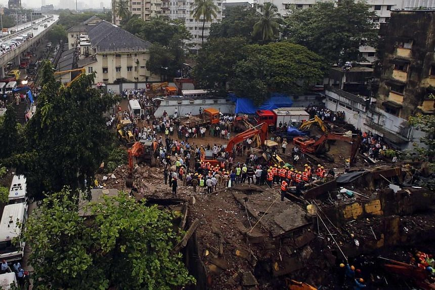 Rescue crews search for survivors at the site of a collapsed residential building in Mumbai on Friday, Sept 27, 2013. The death toll from the collapse of the five-storey apartment block rose to 33 as rescuers frantically searched for around two dozen