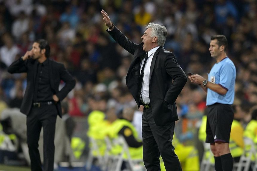 Real Madrid's Italian head coach Carlo Ancelotti reacts during the Spanish league football match Real Madrid CF vs Club Atletico de Madrid. Ancelotti admitted that Atletico Madrid were deserving victors after they handed him his first defeat in charg