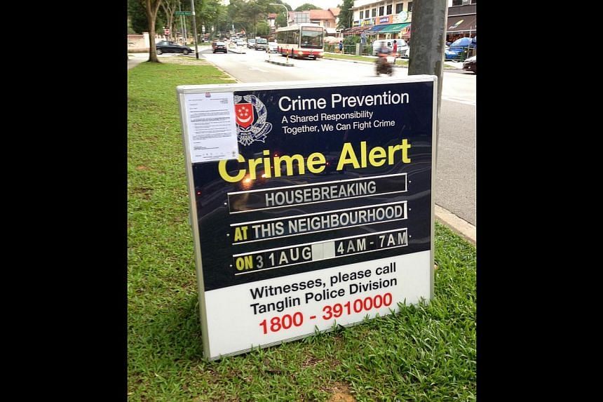 One of the police signs set up in the Bukit Timah area warning residents of a break-in in the neighbourhood. This one was in Sixth Avenue.