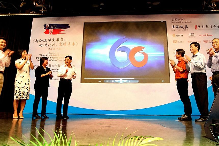 (From left) SCTU adviser Baey Yam Keng, special consultant Sim Ann, president Lian Hwee Eng, Education Minister Heng Swee Keat, NTUC chief Lim Swee Say, NTUC deputy secretary-general Heng Chee How, and SCTU ex-president Chen Keng Juan launching the S