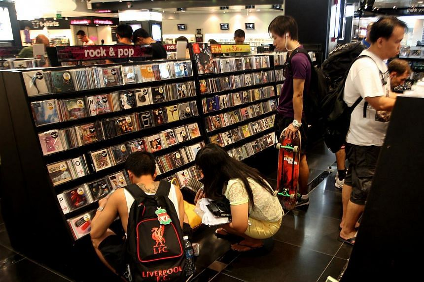 Shoppers browsing in the HMV outlet in 313@Somerset, which is due to close on Nov 4. Speculation over HMV's uncertain future began four years ago when the company downsized its main store - moving from its 17,000 sq ft space in The Heeren to the 12,0