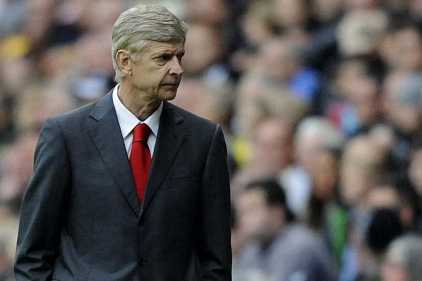 Arsenal's manager Arsene Wenger looks on during their English Premier League soccer match against Swansea City at the Liberty Stadium, Swansea, Wales on Sept 28, 2013. Arsenal manager Arsene Wenger said he was never in any doubt Aaron Ramsey would re