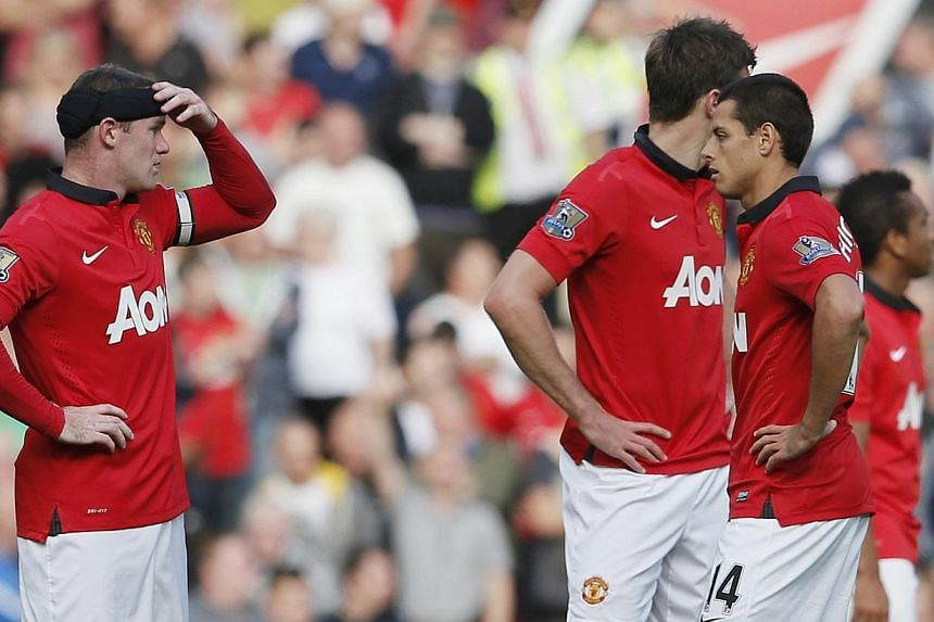 Manchester United players react after a West Bromwich Albion goal during their English Premier League soccer match at Old Trafford in Manchester September 28, 2013. Morgan Amaltifano and Saido Berahino saw West Brom win at Old Trafford for the first
