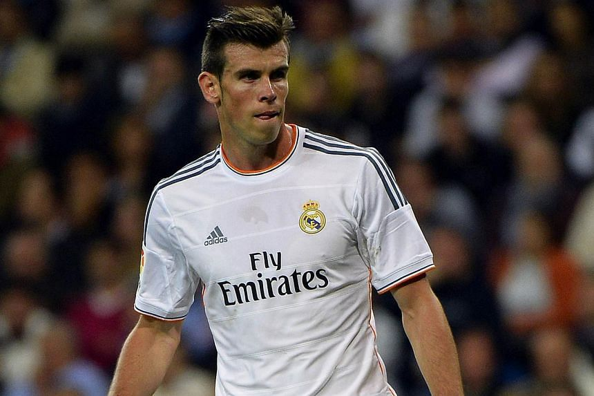 Real Madrid's Welsh striker Gareth Bale looks on during the Spanish league football match Real Madrid CF vs Club Atletico de Madrid at the Santiago Bernabeu stadium in Madrid on Sept 28, 2013. Gareth Bale's long-awaited Real Madrid home debut ended i