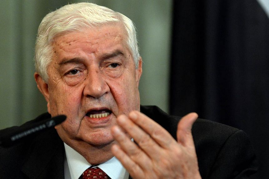 """Syrian Foreign Minister Walid Muallem gives a press conference with his Russian counterpart on Sept 9, 2013 follwing a meeting in Moscow. Syria is """"comfortable"""" with a UN Security Council resolution on destroying its chemical weapons and will not dis"""
