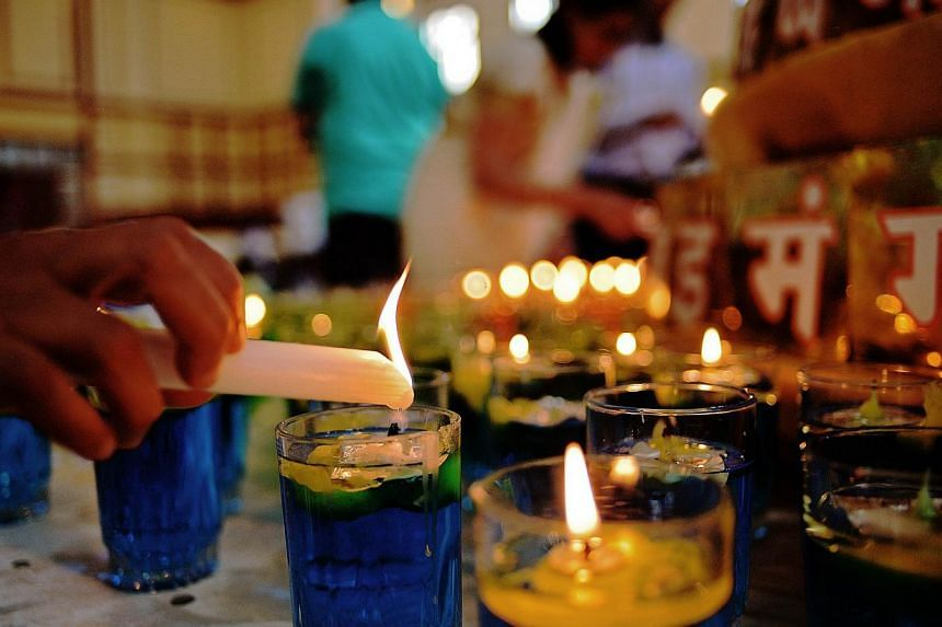A candle is lit at the Oshwal centre at the beginning of a 24 hour Jain prayer vigil for victims of the Westgate mall massacre on Sept 28, 2013. As a jihadist commando sowed death and horror inside Westgate mall last week, Nairobi's Jains became the