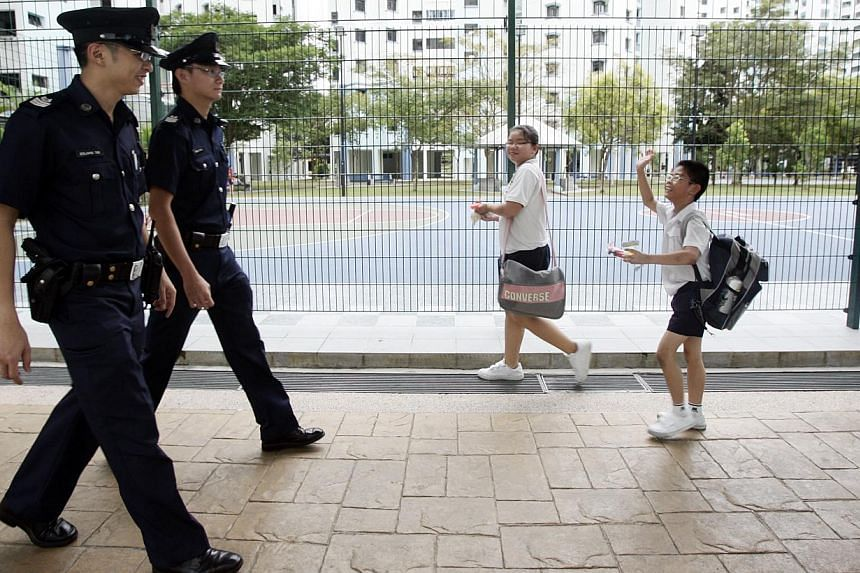 The Singapore Police Force is planning to revamp its service schemes in a bid to better recruit and retain talent. -- ST FILE PHOTO: STEPHANIE YEOW