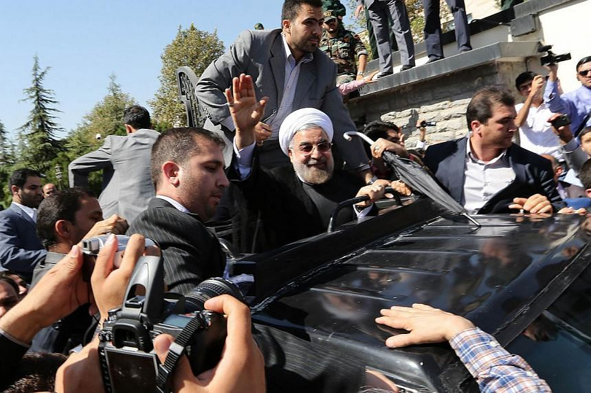 Iranian president Hassan Rouhani waves to supporters as his motorcade leaves Teheran's Mehrabad Airport upon his arrival from New York, on Sept 28, 2013. Iranian President Hassan Rouhani on Saturday brought home a 2,700-year-old Persian artifact the