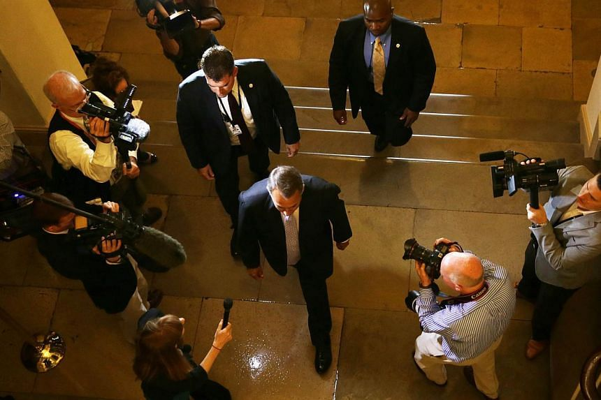 US Speaker of the House Representative John Boehner (centre) arrives at the Capitol for the day September 28, 2013 on Capitol Hill in Washington, DC. -- PHOTO: AFP