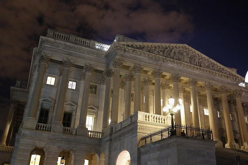 The US House of Representatives remains fully lit during a rare late-night Saturday session at the US Capitol in Washington, Sept 28, 2013. The House of Representatives approved a controversial Republican measure early Sunday that avoids a looming US