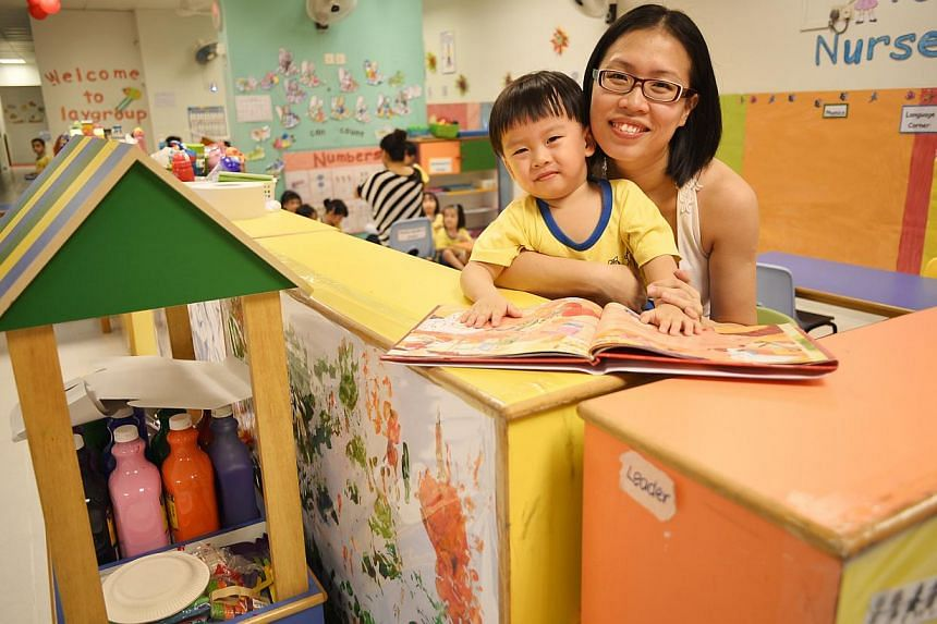 Madam Ong Shi Yee with her son Quek Kai Teng, three, at Star Learners centre. She had to wait two years to get him a place near her home.