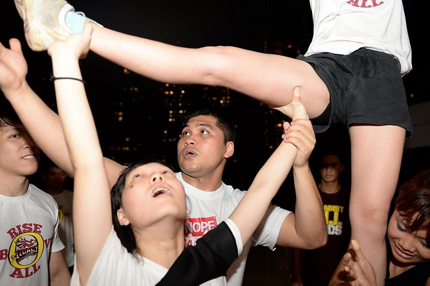 Cheerleading squad Legacy All-Stars during a training session at *Scape in Orchard Road. It is not unusual for teams to put in up to 12 hours of training, seven days a week, in the months leading up to the national cheerleading competition held each