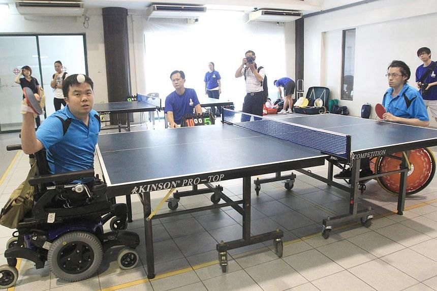 Navy serviceman Jason Chee demonstrating true grit as he storms to victory in a table-tennis competition on Saturday.-- PHOTO: LIANHE ZAOBAO