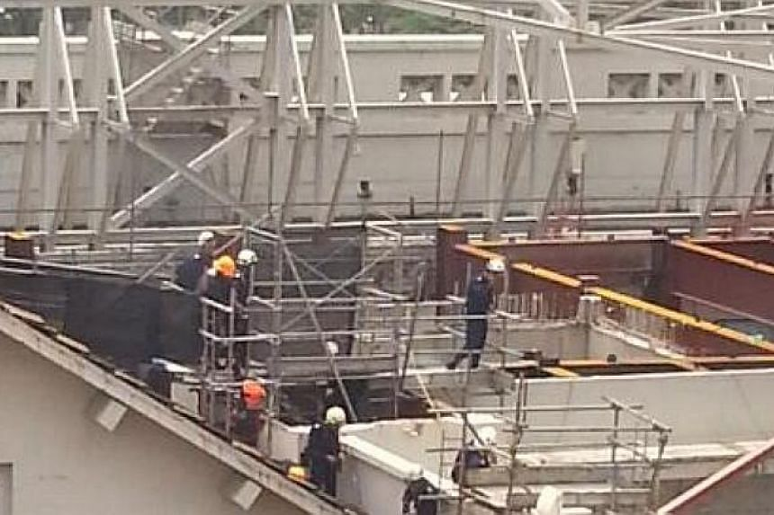 SCDF at the site of the crane collapse at the National Art Gallery worksite. -- PHOTO: TWITTER USER @BOHBABIES