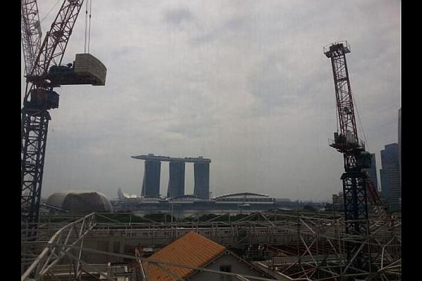 A crane collapsed at the National Art Gallery worksite on Monday morning, crushing metal struts and injuring workers.-- PHOTO: TWITTER USER @BOHBABIES