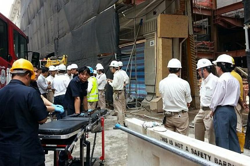 At least two construction workers were killed and another three seriously injured after an accident on Monday morning at the worksite for the future National Art Gallery Singapore on Supreme Court Lane.-- ST PHOTO: DAVID EE