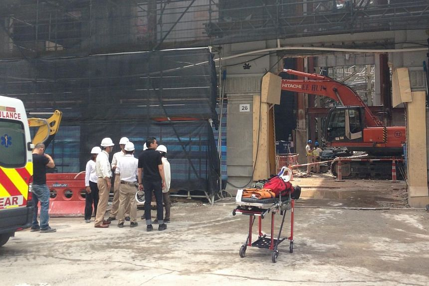 At least two construction workers were killed and another three seriously injured after an accident on Monday morning at the worksite for the future National Art Gallery Singapore on Supreme Court Lane.-- ST PHOTO: MUGILAN RAJASEGARAN