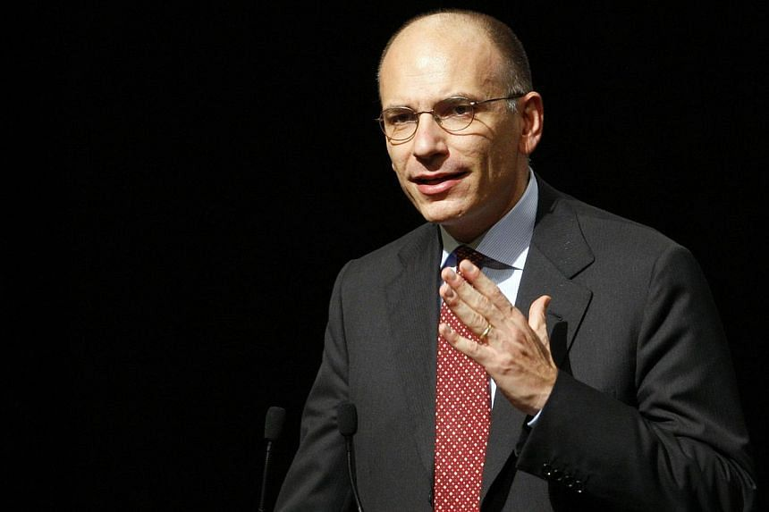 Italy's Prime Minister Enrico Letta gestures during a meeting in Rome, Sept 29, 2013. Italian Prime Minister Enrico Letta called a parliamentary vote of confidence in his teetering left-right government on Wednesday amid a tug-of-war over Silvio Berl