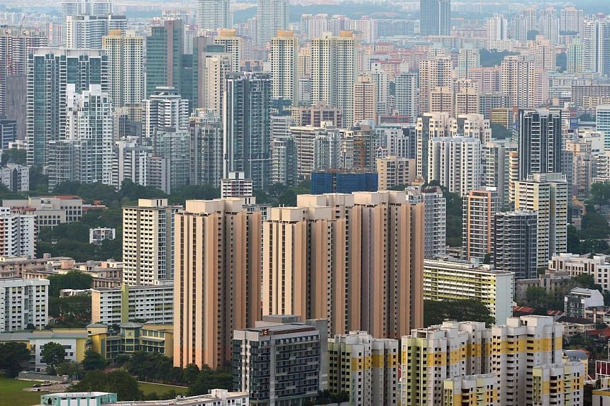 High-rise private and government residential buildings in Singapore. Resale homes saw a small rise in prices last month, led by units in the suburbs and shoebox apartments. -- ST FILE PHOTO: ALPHONSUS CHERN
