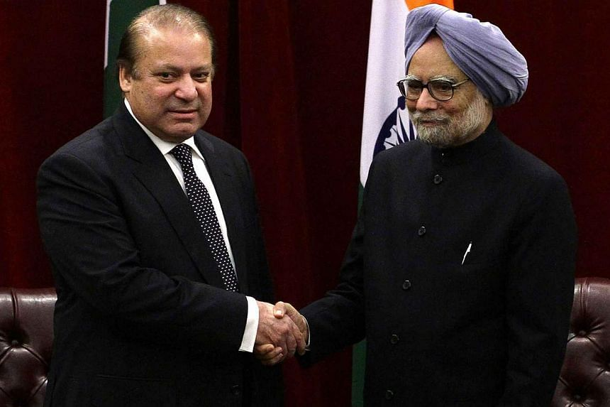 Pakistan's Prime Minister Nawaz Sharif (left) shakes hands with India's Prime Minister Manmohan Singh during the United Nations General Assembly at the New York Palace hotel in New York on Sept 29, 2013. The leaders of India and Pakistan pledged on S