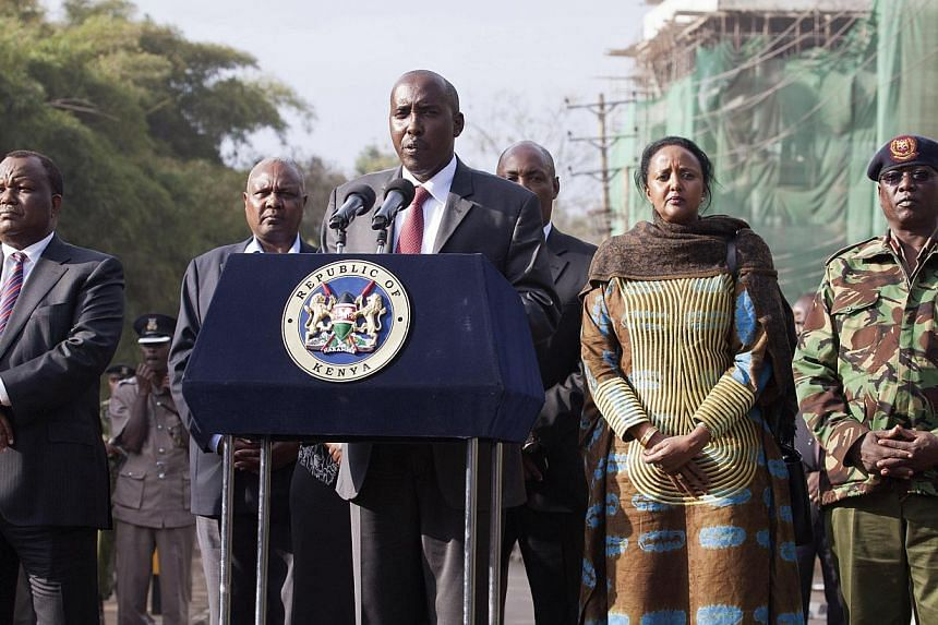 Kenya's Interior Minister Joseph Ole Lenku (centre), flanked other government officials, speaks during a news conference near the Westgate shopping mall in Nairobi Sept 25, 2013. Kenya rebuked the United States on Sunday for warning its citizens over