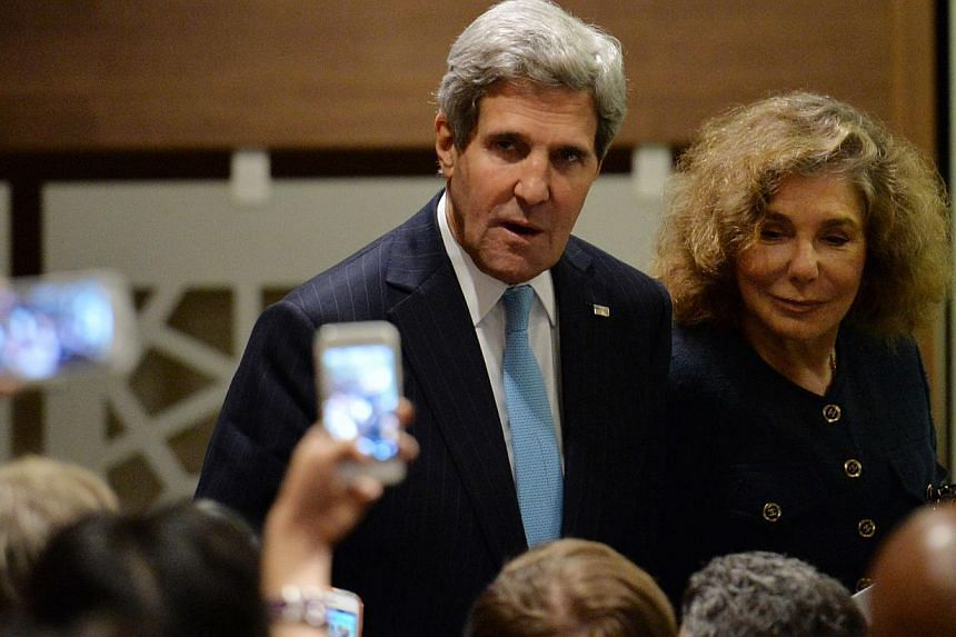 US Secretary of State John Kerry (centre) with wife Teresa Heinz (right) walks past the media outside the United Nations Security Council on Sept 27, 2013, at UN headquarters in New York. US Secretary of State John Kerry said on Sunday a deal with Ir