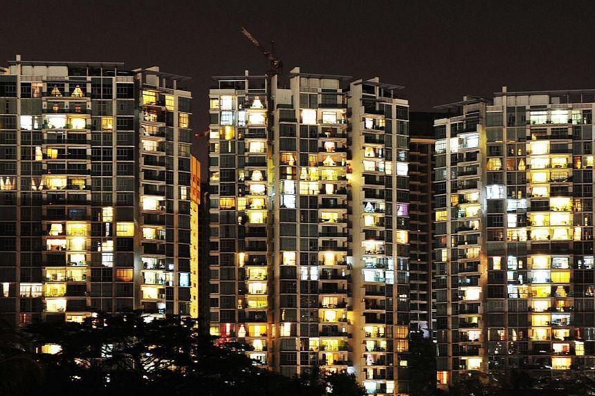 Lighted windows in a condominium on Feb 27, 2011. About 800,000 Singaporean Housing Board (HDB) households will receive $45m worth of GST Voucher - Utilities-Save (U-Save) rebates in October. -- ST FILE PHOTO: ALPHONSUS CHERN