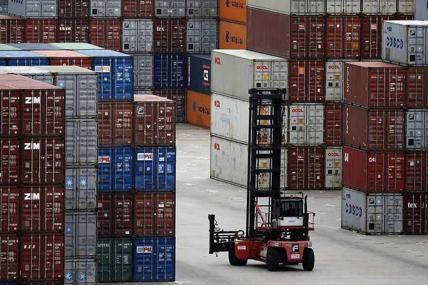 A container forklift drives past the container area at the Yangshan Deep Water Port, part of the newly announced Shanghai Free Trade Zone, south of Shanghai, Sept 26, 2013. The launch of a Shanghai free trade zone heralds a new chapter in China's dri