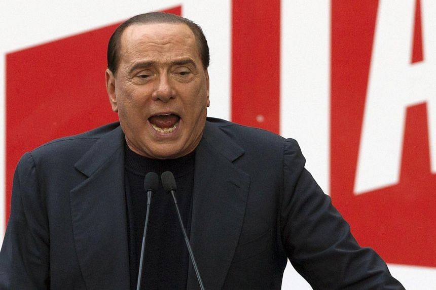 Former Italian Premier Silvio Berlusconi addresses supporters during a demonstration in front of his residence in Rome on Aug 4, 2013. Mr Berlusconi's bid to push Italy into new elections faces a test on Monday when he meets lawmakers from his centre
