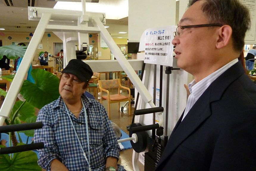 Mr Matsunage Masatake telling Health Minister Gan Kim Yong of his daily exercise regime at the day rehabilitation centre following his fall and fractured hip. There are gaps in Singapore's eldercare services that need to be plugged if more old people