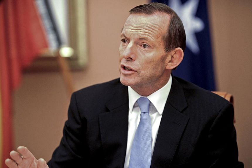Australia's new Prime Minister Tony Abbott attends the first meeting of the full ministry at Parliament House in Canberra, Wednesday, Sept 18, 2013. Australia's new Prime Minister Tony Abbott begins a visit to Indonesia on Monday for talks on his tou