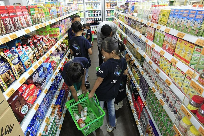Beneficiaries of The Straits Times School Pocket Money Fund shopping at a Cheers convenience store outlet in Downtown East on Aug 31, 2013. The Straits Times School Pocket Money Fund (SPMF) will increase the monthly amount it gives to students from l