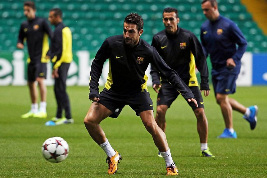 Barcelona's Spanish midfielder Cesc Fabregas takes part in a training session at Celtic Park, Glasgow, Scotland, on Sept 30, 2013 on the eve of the UEFA Champions League group H football match between Celtic and Barcelona. Cesc Fabregas has challenge