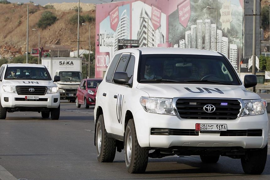 The convoy of a UN team of weapons inspectors, who concluded its almost week-long mission in Syria, arrive at Rafik Hariri international airport in Beirut, Lebanon, Monday, Sept 30, 2013. A chemical weapons disarmament team crossed into Syria from Le
