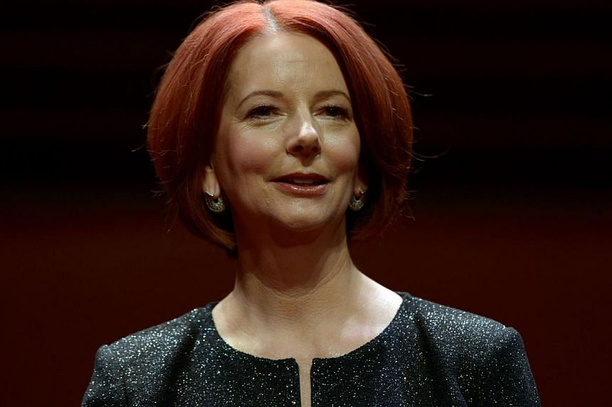 Australia's former prime minister Julia Gillard poses for a photographs prior to a televised interview in front of a live audience at the Sydney Opera House on September 30, 2013. The interview is Julia Gillard's first public appearance since she was