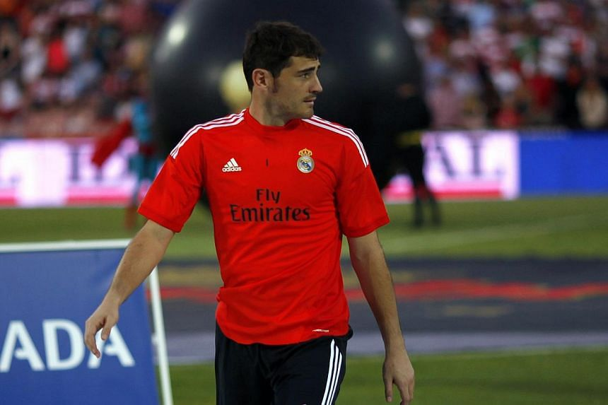 Real Madrid's goalkeeper Iker Casillas leaves the pitch before their Spanish first division football match against Granada at Los Carmenes stadium on Aug 26, 2013.Casillas will make his first appearance at the Santiago Bernabeu in nearly nine m