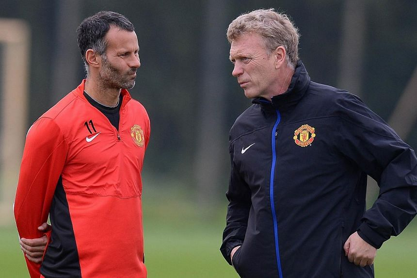 Manchester United's Ryan Giggs (left) listens tomanager David Moyes during a training session in Manchester on Oct 1, 2013. Should Moyes turn to the evergreen midfielder on Wednesday against Shakhtar Donetsk in the Champions League, Giggs will