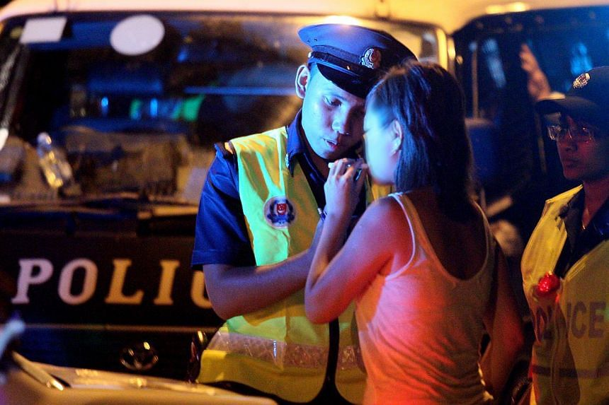 Officers from the Traffic Police conducting a breathalyser test on a motorist during a roadblock at Buangkok East Drive. Drink-driving laws in Singapore are now easier to apply, following new sentencing guidelines laid down by Chief Justice Sundaresh