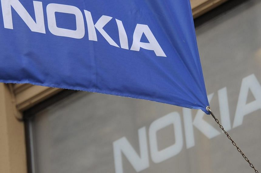 Nokia's flag outside the flagship store of Finnish mobile phone manufacturer Nokia in Helsink. The Indian authorities have frozen some of Finnish telecom giant Nokia's assets, the company said on Tuesday, amid a 20 billion rupee (S$400 million)
