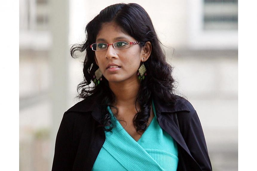 Subashini Jeyabal, 28, daughter of the woman who sued the Novena Church unsuccessfully for what she said was an botched exorcism seven years ago was in court on Tuesday for charges of slapping her father and kicking her mother. -- ST FILE PHOTO: LAU