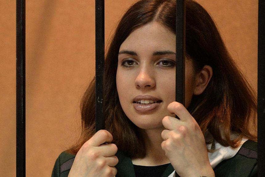 Pussy Riot punk band member Nadezhda Tolokonnikova standing in the defendant's cage in a court in the town of Zubova Polyana in the Republic of Mordovia on April 26, 2013. Jailed Pussy Riot punk band member Nadezhda Tolokonnikova has been put on an I
